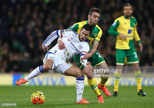 Eden Hazard of Chelsea controls the ball under pressure of Ivo Pinto of Norwich City during the Barclays Premier League match between Norwich City...