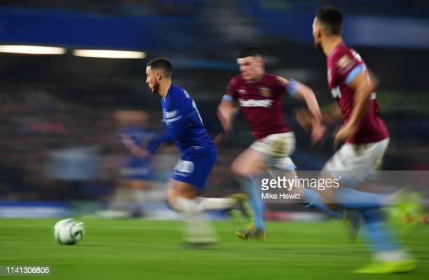 Eden Hazard of Chelsea evades Declan Rice of West Ham United during the Premier League match between Chelsea FC and West Ham United at Stamford...