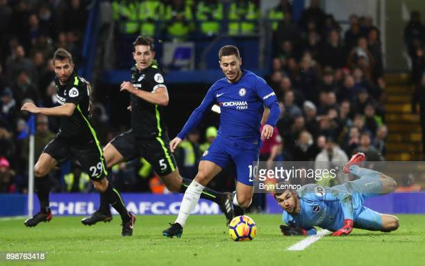 Eden Hazard of Chelsea evades Markus Suttner Lewis Dunk and Mathew Ryan of Brighton and Hove Albion during the Premier League match between Chelsea...