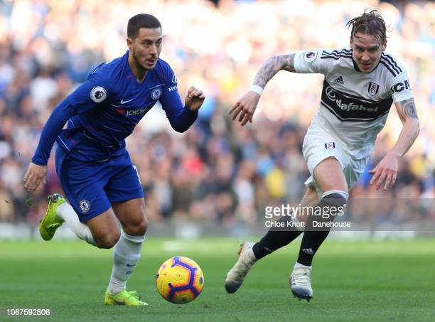 Eden Hazard of Chelsea FC and Stefan Johansen of Fulham FC in action during the Premier League match between Chelsea FC and Fulham FC at Stamford...