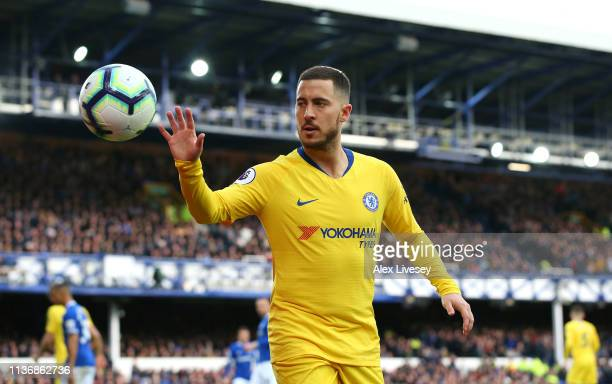 Eden Hazard of Chelsea FC collects the ball during the Premier League match between Everton FC and Chelsea FC at Goodison Park on March 17 2019 in...