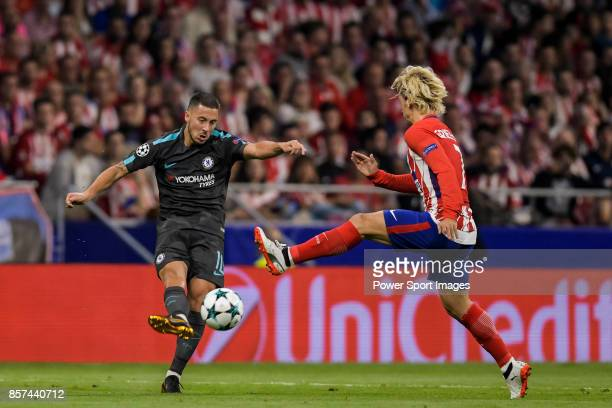 Eden Hazard of Chelsea FC fights for the ball with Antoine Griezmann of Atletico de Madrid during the UEFA Champions League 201718 match between...