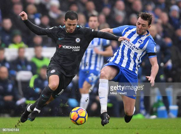 Eden Hazard of Chelsea gets past Dale Stephens of Brighton during the Premier League match between Brighton and Hove Albion and Chelsea at Amex...