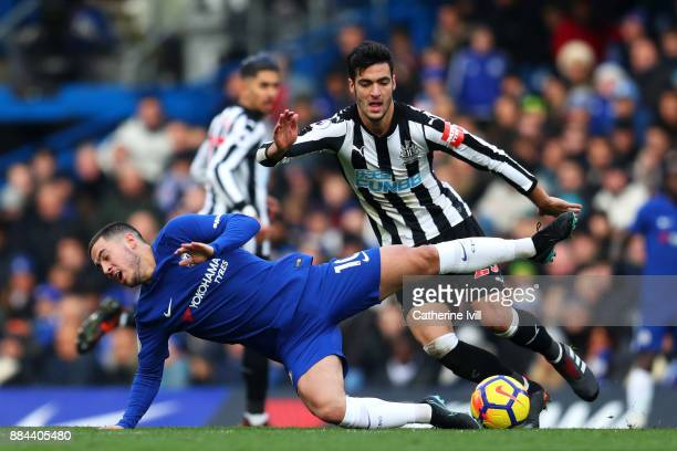 Eden Hazard of Chelsea goes down as Mikel Merino of Newcastle United runs with the ball during the Premier League match between Chelsea and Newcastle...