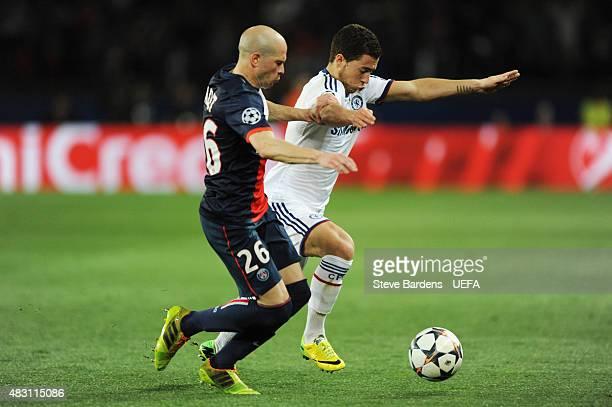 Eden Hazard of Chelsea holds off Christophe Jallet of PSG during the UEFA Champions League Quarter Final first leg match between Paris SaintGermain...