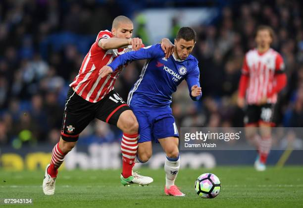 Eden Hazard of Chelsea holds off Oriol Romeu of Southampton during the Premier League match between Chelsea and Southampton at Stamford Bridge on...