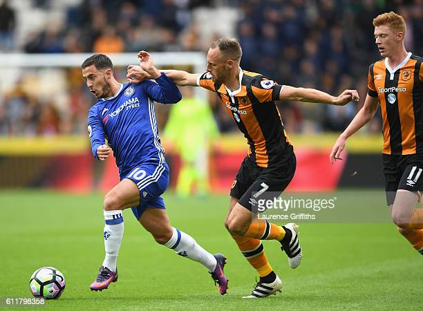 Eden Hazard of Chelsea holds off pressure from David Meyler of Hull during the Premier League match between Hull City and Chelsea at KCOM Stadium on...