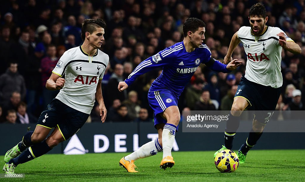 Eden Hazard (C) of Chelsea in action against Erik Lamela (L) and Federico Fazio (R) of Tottenham Hotspur during the Barclays Premier League match between Chelsea and Tottenham Hotspur at Stamford Bridge in London, England on December 03, 2014.