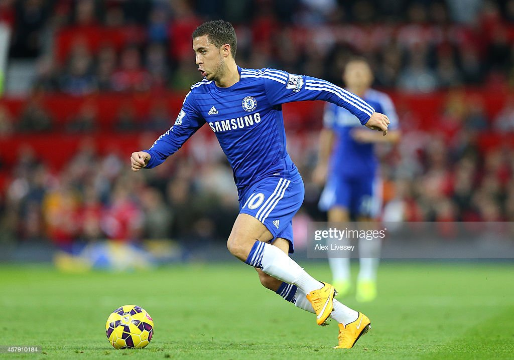 Eden Hazard of Chelsea in action during the Barclays Premier League match between Manchester United and Chelsea at Old Trafford on October 26, 2014 in Manchester, England.