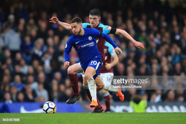 Eden Hazard of Chelsea in action with Declan Rice of West Ham during the Premier League match between Chelsea and West Ham United at Stamford Bridge...