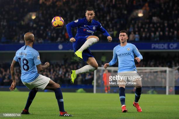 Eden Hazard of Chelsea in action with Fabian Delph and Aymeric Laporte of Manchester City during the Premier League match between Chelsea FC and...