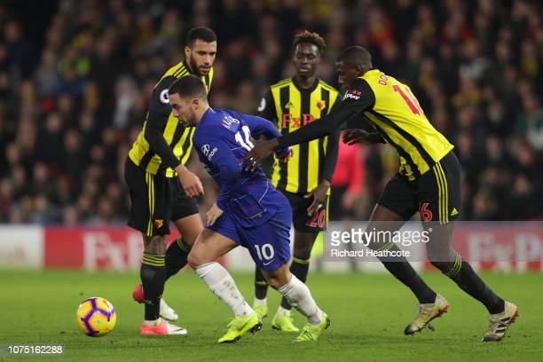 Eden Hazard of Chelsea is challanged by Domingos Quina of Watford and Abdoulaye Doucoure of Watford during the Premier League match between Watford...