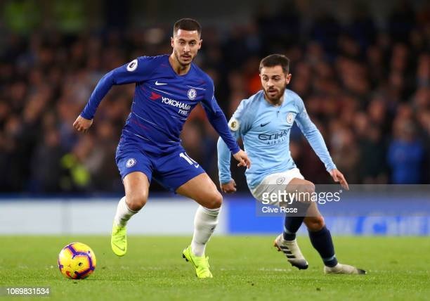 Eden Hazard of Chelsea is challenged by Bernardo Silva of Manchester City during the Premier League match between Chelsea FC and Manchester City at...