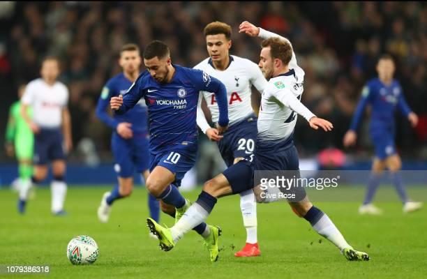 Eden Hazard of Chelsea is challenged by Christian Eriksen of Tottenham Hotspur during the Carabao Cup SemiFinal First Leg match between Tottenham...