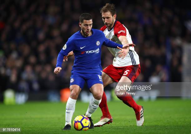 Eden Hazard of Chelsea is challenged by Craig Dawson of West Bromwich Albion during the Premier League match between Chelsea and West Bromwich Albion...