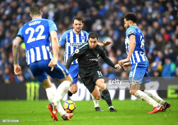 Eden Hazard of Chelsea is challenged by Dale Stephens of Brighton and Hove Albion during the Premier League match between Brighton and Hove Albion...