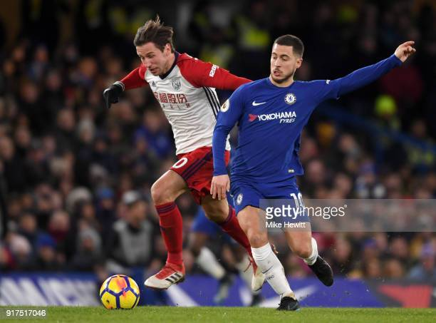 Eden Hazard of Chelsea is challenged by Grzegorz Krychowiak of West Bromwich Albion during the Premier League match between Chelsea and West Bromwich...