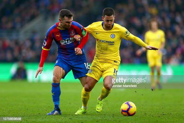 Eden Hazard of Chelsea is challenged by James McArthur of Crystal Palace during the Premier League match between Crystal Palace and Chelsea FC at...