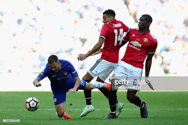 Eden Hazard of Chelsea is challenged by Jesse Lingard and Paul Pogba both of Manchester United during the Emirates FA Cup Final between Chelsea and...