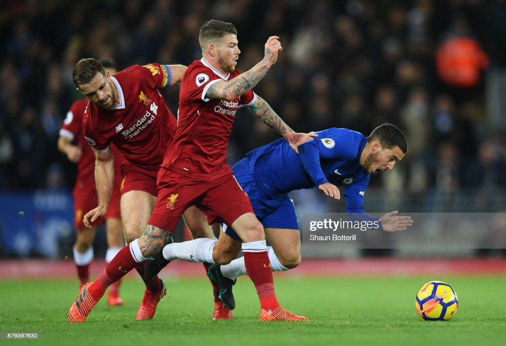 Eden Hazard of Chelsea is challenged by Jordan Henderson and Alberto Moreno of Liverpool during the Premier League match between Liverpool and Chelsea at Anfield on November 25, 2017 in Liverpool, England.