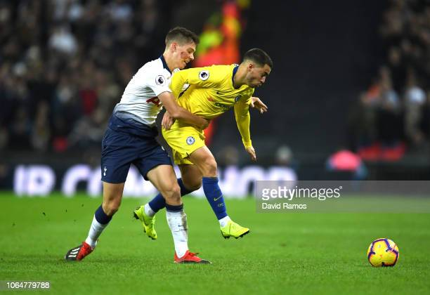 Eden Hazard of Chelsea is challenged by Juan Foyth of Tottenham Hotspur during the Premier League match between Tottenham Hotspur and Chelsea FC at...