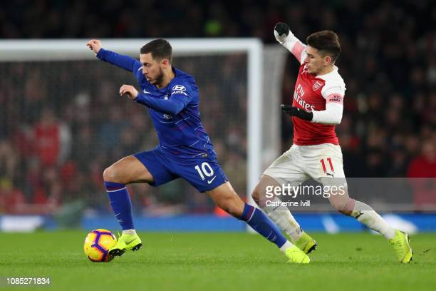 Eden Hazard of Chelsea is challenged by Lucas Torreira of Arsenal during the Premier League match between Arsenal FC and Chelsea FC at Emirates...