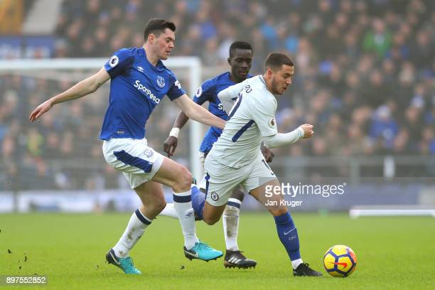 Eden Hazard of Chelsea is challenged by Michael Keane of Everton during the Premier League match between Everton and Chelsea at Goodison Park on...