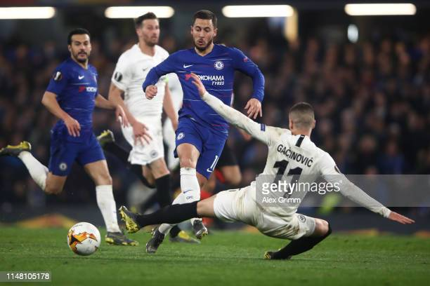 Eden Hazard of Chelsea is challenged by Mijat Gacinovic of Frankfurt during the UEFA Europa League Semi Final Second Leg match between Chelsea and...