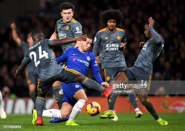 Eden Hazard of Chelsea is challenged by Nampalys Mendy of Leicester City and Ricardo Pereira of Leicester City during the Premier League match...