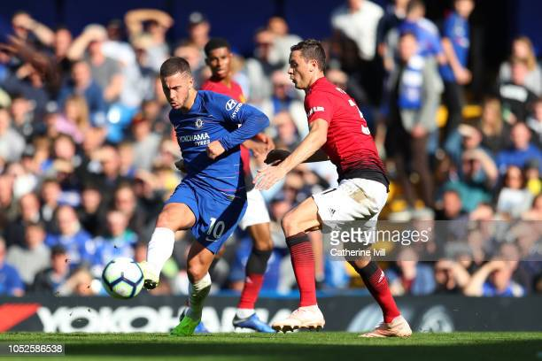 Eden Hazard of Chelsea is challenged by Nemanja Matic of Manchester United during the Premier League match between Chelsea FC and Manchester United...