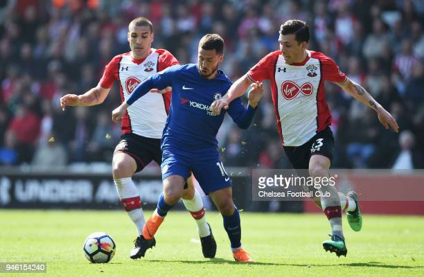 Eden Hazard of Chelsea is challenged by Oriol Romeu of Southampton and PierreEmile Hojbjerg of Southampton during the Premier League match between...