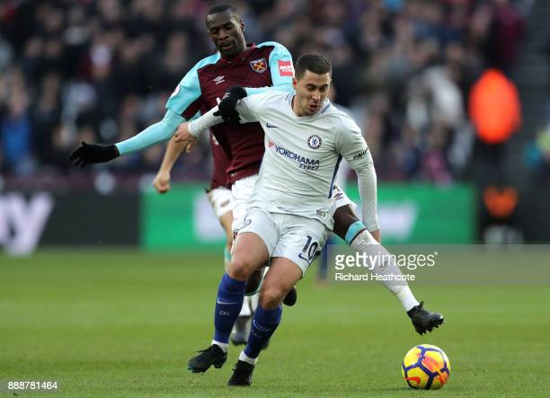 Eden Hazard of Chelsea is challenged by Pedro Obiang of West Ham United during the Premier League match between West Ham United and Chelsea at London...