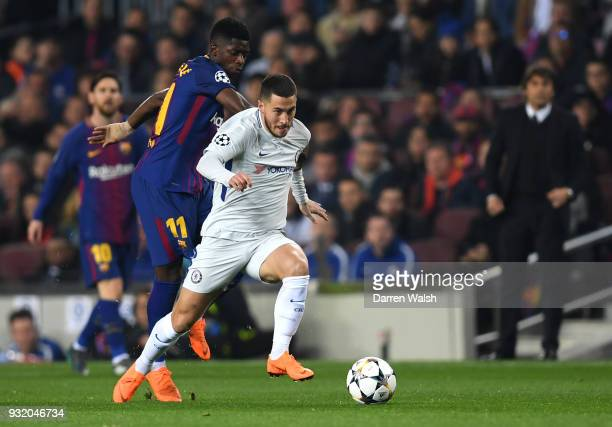 Eden Hazard of Chelsea is challenged by Samuel Umtiti of Barcelona during the UEFA Champions League Round of 16 Second Leg match FC Barcelona and...