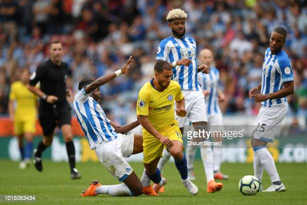 Eden Hazard of Chelsea is challenged by Terence Kongolo of Huddersfield Town during the Premier League match between Huddersfield Town and Chelsea FC...