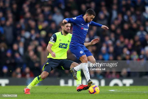 Eden Hazard of Chelsea is challenged by Tommy Smith of Huddersfield Town during the Premier League match between Chelsea FC and Huddersfield Town at...