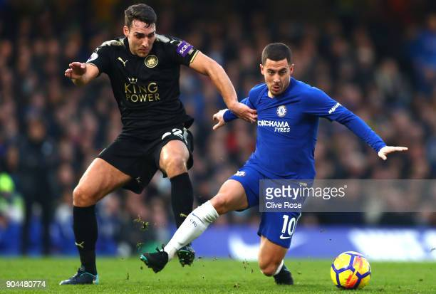Eden Hazard of Chelsea is challenged by Vicente Iborra of Leicester City during the Premier League match between Chelsea and Leicester City at...