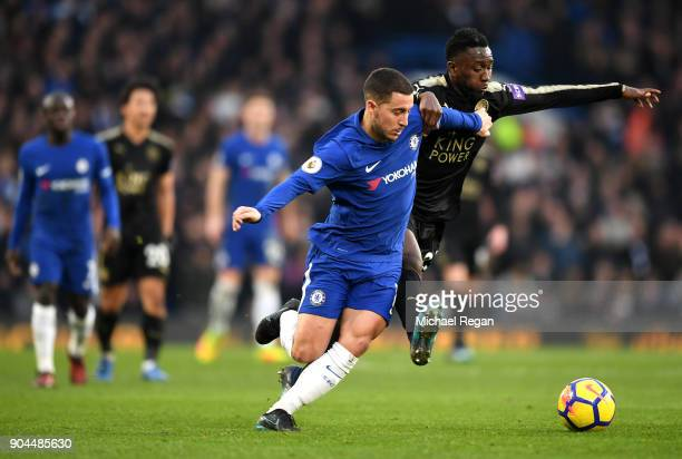 Eden Hazard of Chelsea is challenged by Wilfred Ndidi of Leicester City during the Premier League match between Chelsea and Leicester City at...