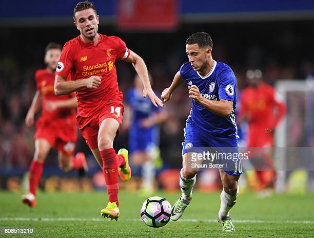 Eden Hazard of Chelsea is chased by Jordan Henderson of Liverpool during the Premier League match between Chelsea and Liverpool at Stamford Bridge on...