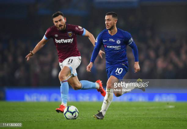 Eden Hazard of Chelsea is chased by Robert Snodgrass of West Ham United during the Premier League match between Chelsea FC and West Ham United at...