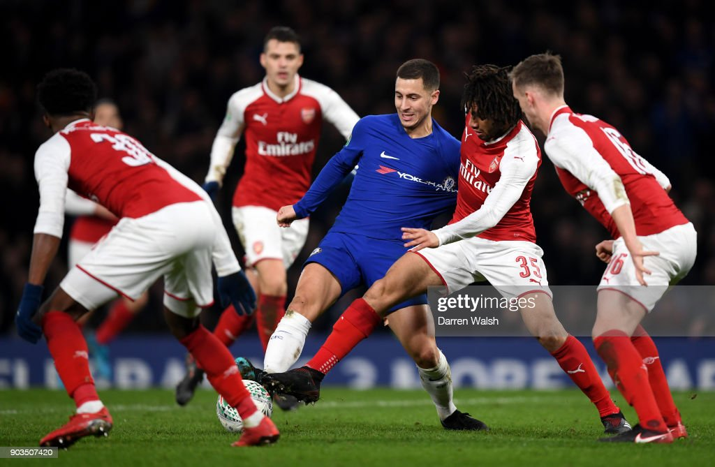 Eden Hazard of Chelsea is closed down by Mohamed Elneny of Arsenal during the Carabao Cup Semi-Final First Leg match between Chelsea and Arsenal at Stamford Bridge on January 10, 2018 in London, England.