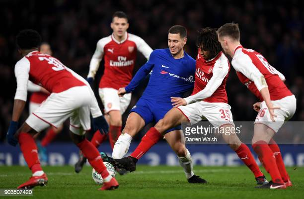 Eden Hazard of Chelsea is closed down by Mohamed Elneny of Arsenal during the Carabao Cup SemiFinal First Leg match between Chelsea and Arsenal at...