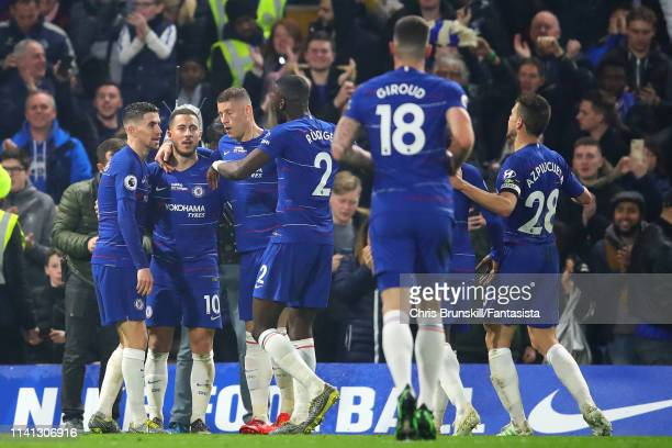 Eden Hazard of Chelsea is congratulated by his teammates after scoring his side's second goal during the Premier League match between Chelsea FC and...