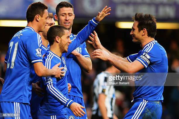 Eden Hazard of Chelsea is congratulated by team mates including Frank Lampard after scoring his third goal from the penalty spot during the Barclays...