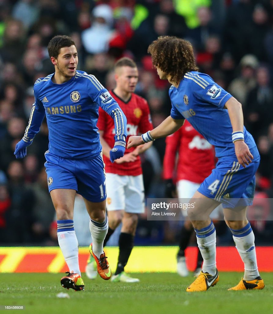 Eden Hazard (l) of Chelsea is congratulated by team-mate David Luiz after scoring his team's first goal during the FA Cup sponsored by Budweiser Sixth Round match between Manchester United and Chelsea at Old Trafford on March 10, 2013 in Manchester, England.