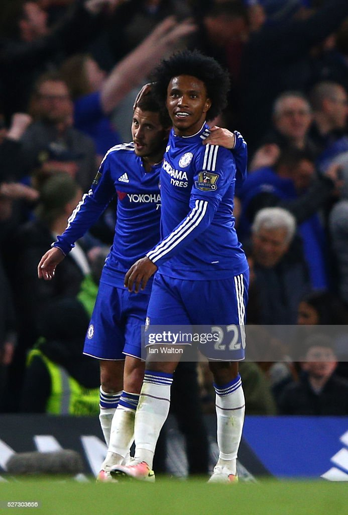 Eden Hazard of Chelsea is congratulated by teammate Willian after scoring his team's second goal during the Barclays Premier League match between Chelsea and Tottenham Hotspur at Stamford Bridge on May 02, 2016 in London, England.
