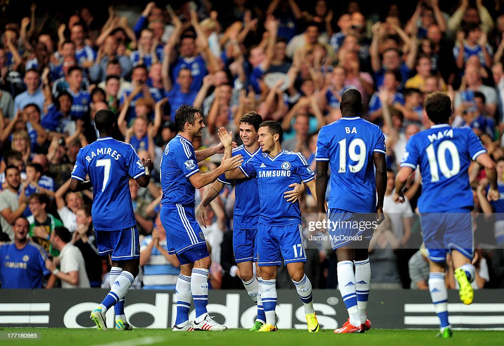 Eden Hazard #17 of Chelsea is congratulated by teammates after scoring the opening goal during the Barclays Premier League match between Chelsea and Aston Villa at Stamford Bridge on August 21, 2013 in London, England.