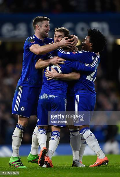Eden Hazard of Chelsea is congratulated by teammates Gary Cahill Branislav Ivanovic and Willian after scoring his team's fourth goal during The...