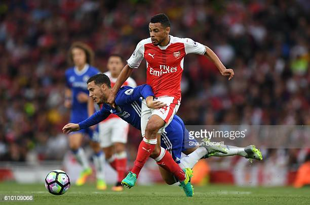 Eden Hazard of Chelsea is fouled by Francis Coquelin of Arsneal during the Premier League match between Arsenal and Chelsea at the Emirates Stadium...