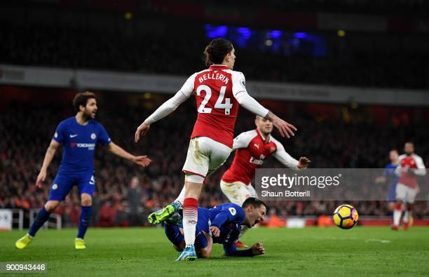 Eden Hazard of Chelsea is fouled by Hector Bellerin of Arsenal which leads to Chelsea being awarded a penalty by match referee Anthony Taylor during...