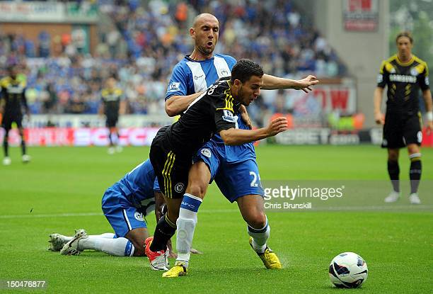 Eden Hazard of Chelsea is fouled by Ivan Ramis of Wigan Athletic for a penalty during the Barclays Premier League match between Wigan Athletic and...